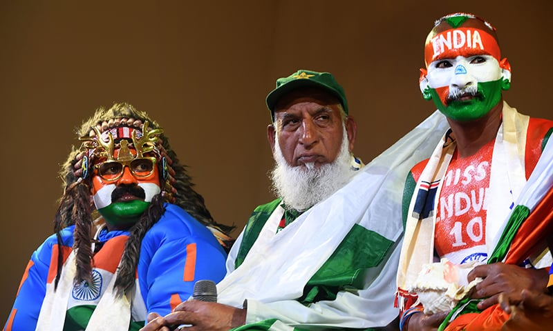 "Pakistan cricket fan ""Chacha Cricket"", AKA Chacha Sufi Jalil (C) and Indian cricket fan Sudhir Gautam (R) attend a super-fan event in Manchester on June 14 ahead of the India v Pakistan 2019 World Cup cricket match. — AFP"