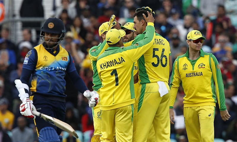 Australia's Mitchell Starc (C) celebrates with teammates after taking the wicket of Sri Lanka's Milinda Siriwardana (L) for three during the 2019 Cricket World Cup group stage match between Sri Lanka and Australia at The Oval in London. — AFP