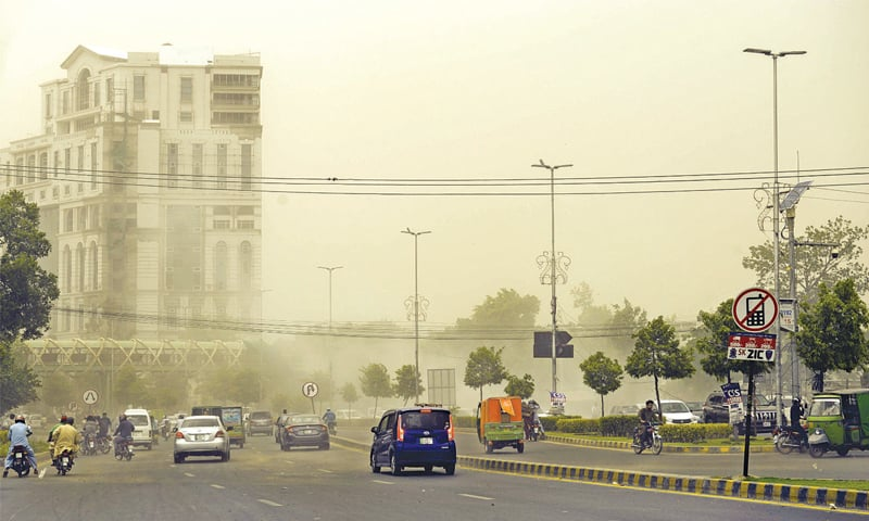 A view of Jail Road during a dust storm that hit the city on Saturday. — White Star / Murtaza Ali