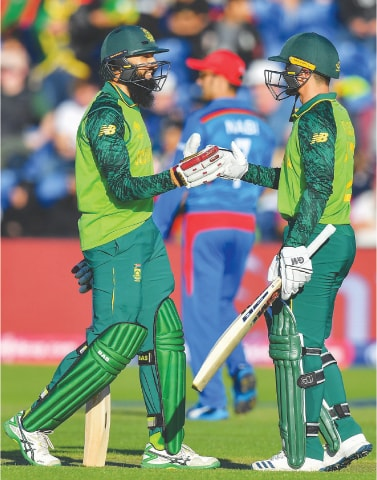 CARDIFF: South Africa's Hashim Amla and Quinton de Kock celebrate their hundred partnership against Afghanistan on Saturday.—AFP