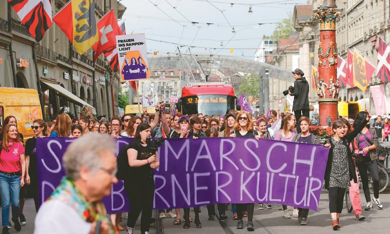 Bern: Women take part in a nation-wide women's strike for wage parity, on Friday in Swiss capital. — AFP