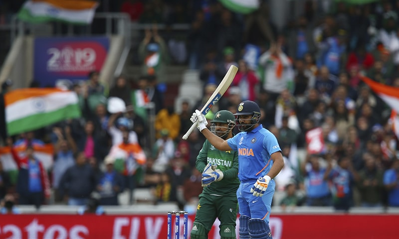 Rohit Sharma celebrates reaching a half century during the Cricket World Cup match between India and Pakistan at Old Trafford on June 16. — AP