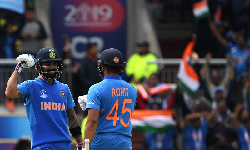 India's captain Virat Kohli (L) celebrates with teammate Rohit Sharma after the innings passed 150 during the 2019 Cricket World Cup group stage match between India and Pakistan. — AFP