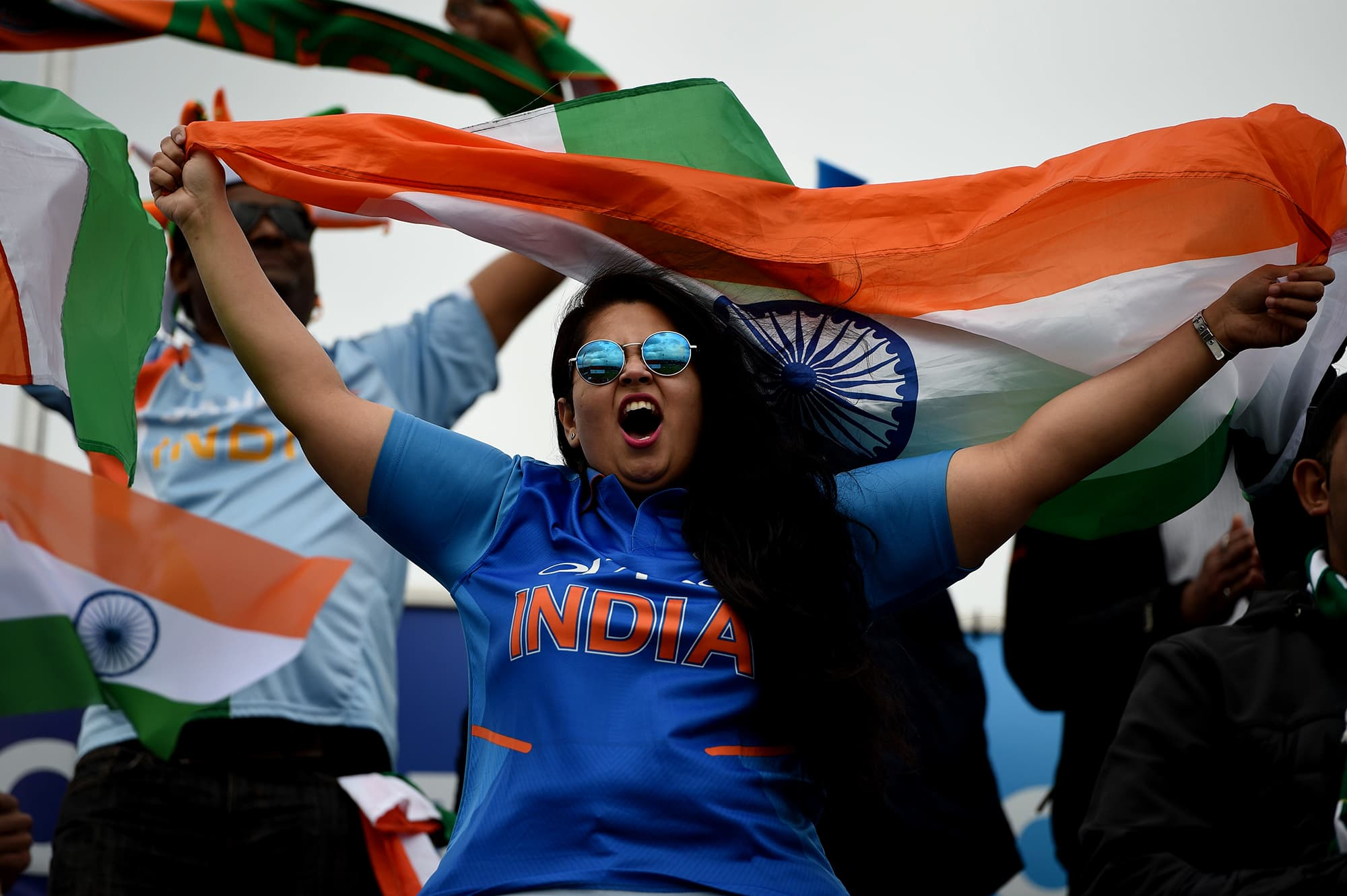 A Indian supporter waves a flag in the crowd ahead of the match. — AFP