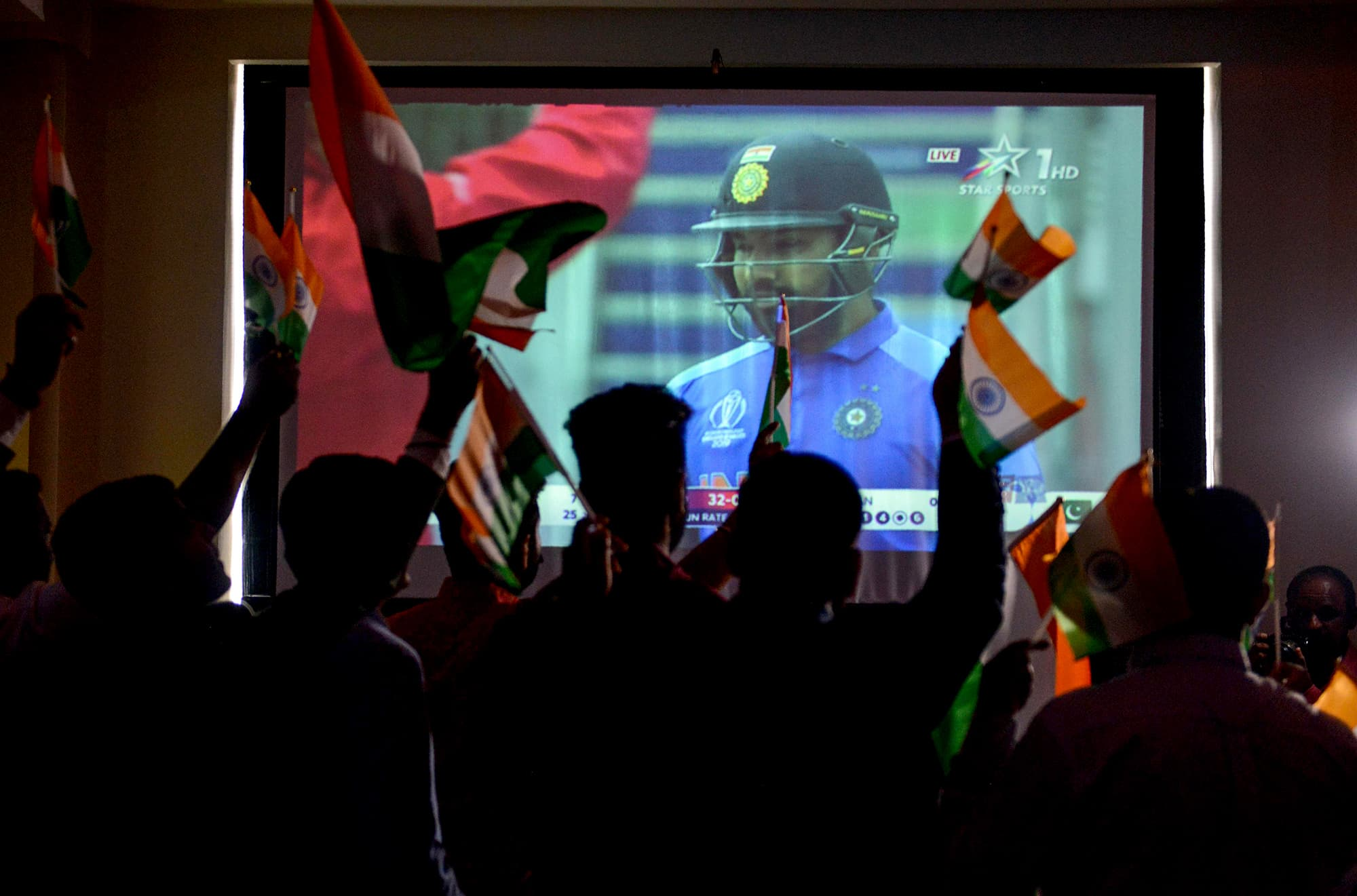 Meanwhile, Indian cricket fans watch a live broadcast of the match at a hotel in Amritsar. ─ AFP