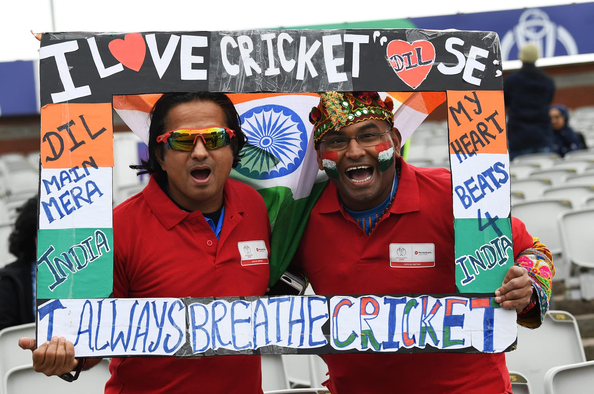 Indian supporters pose ahead of the match. ─ AFP