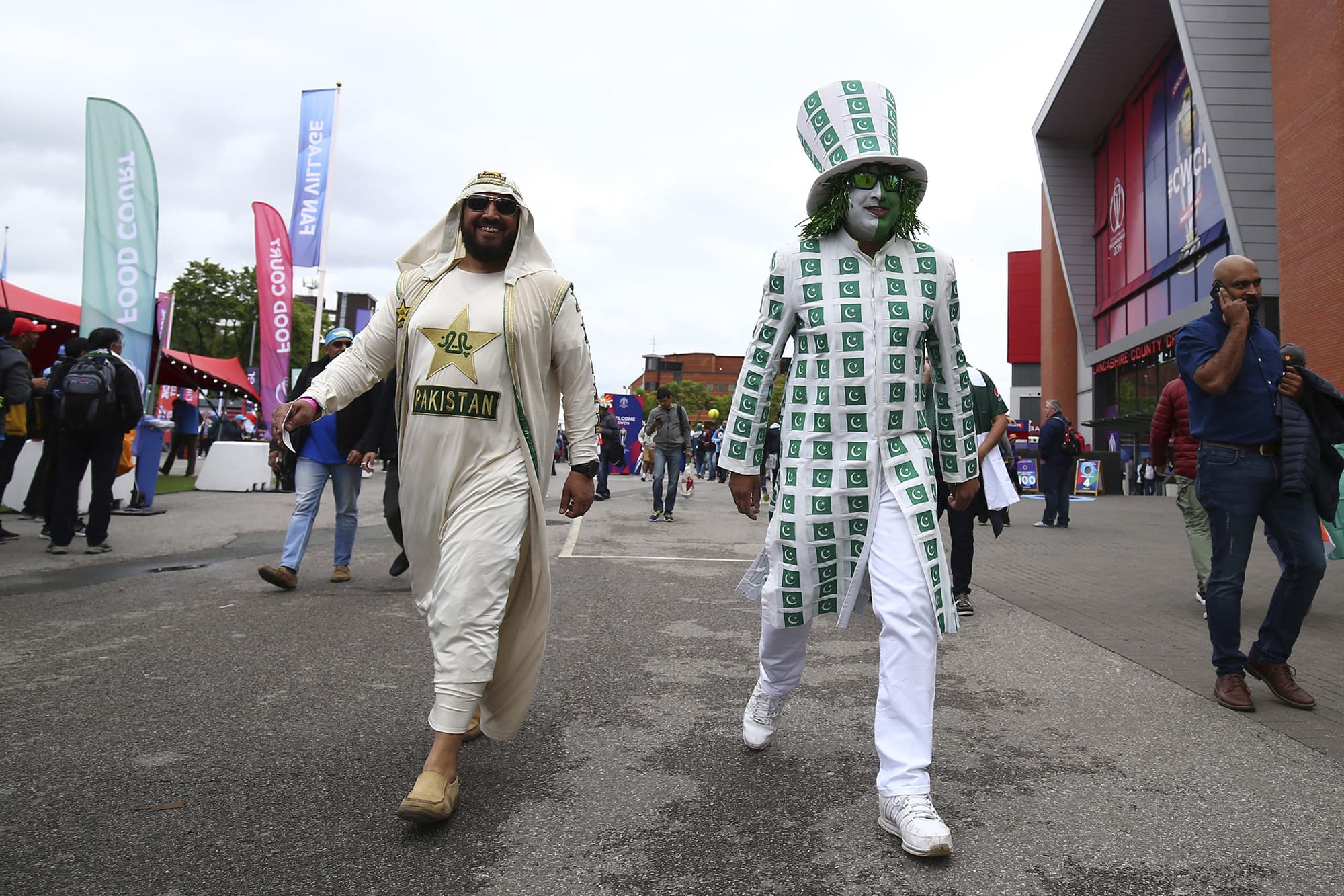 A closer look at the costumes worn by some Pakistani supporters in the crowd. ─ AP
