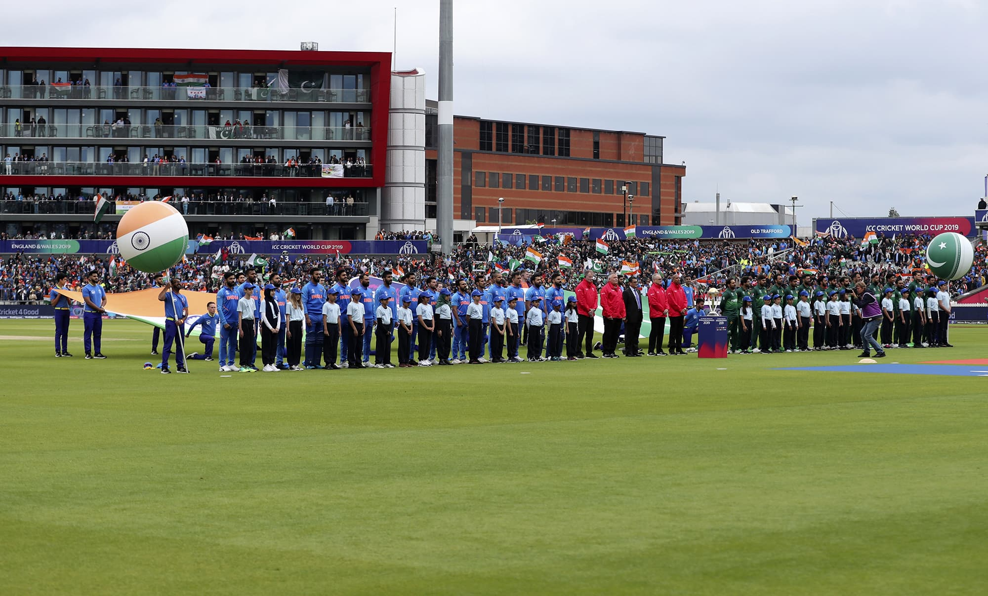 Indian and Pakistan players stand for their national anthems before the start of the match. ─ AP