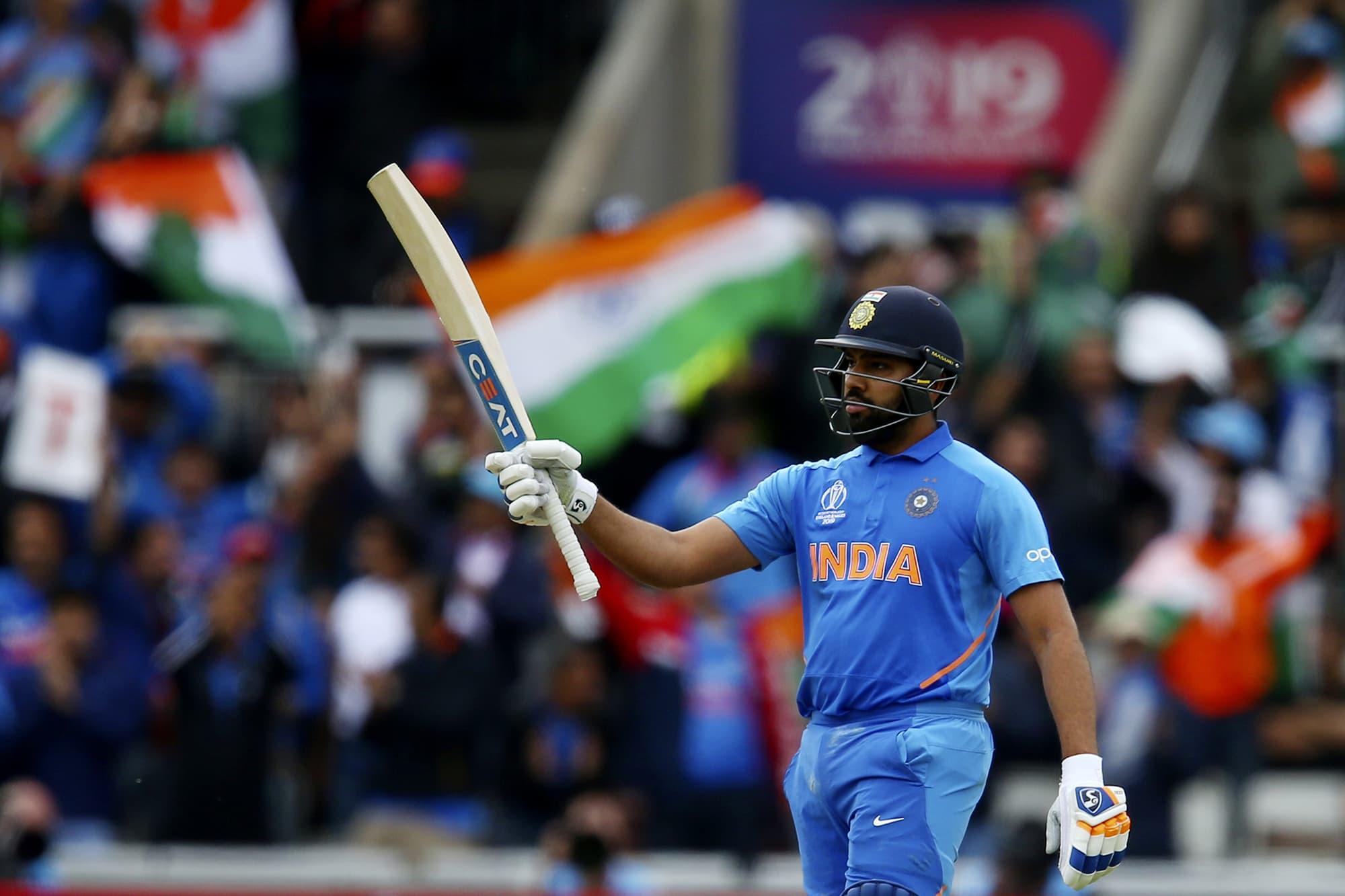 Rahul celebrates reaching a half century. ─ AP