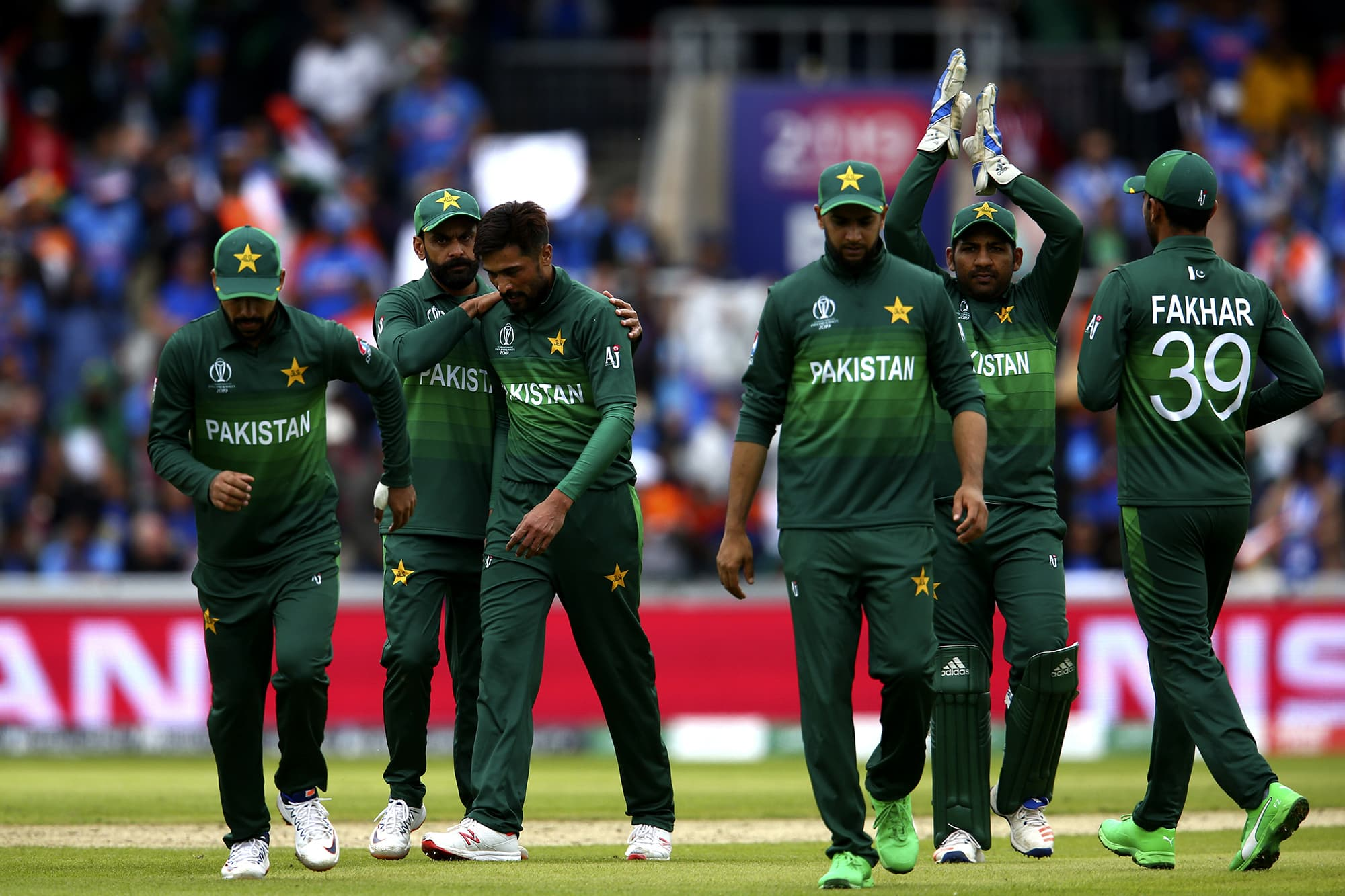 Babar Azam is congratulated by his teammates for taking the wicket of Hardik Pandya. ─ AP