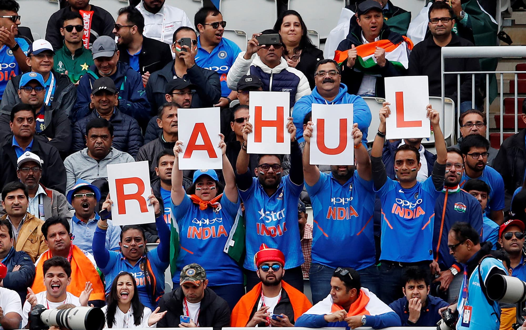 Indian fans hold up a banner in support of K.L. Rahul. ─ Reuters