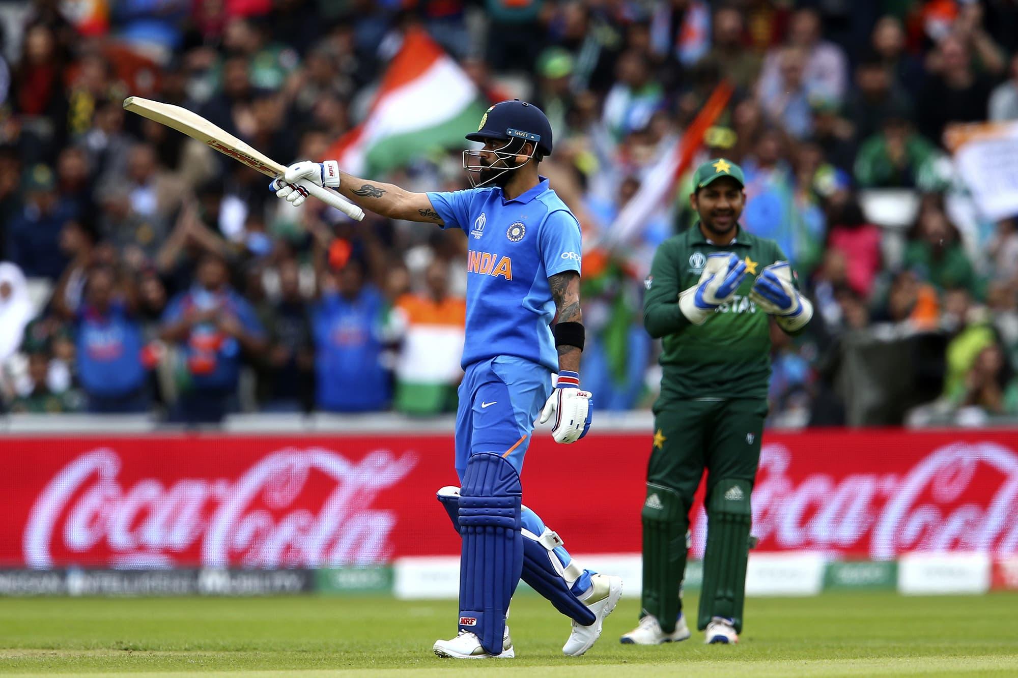 Virat Kohli celebrates reaching a half-century. ─ AP