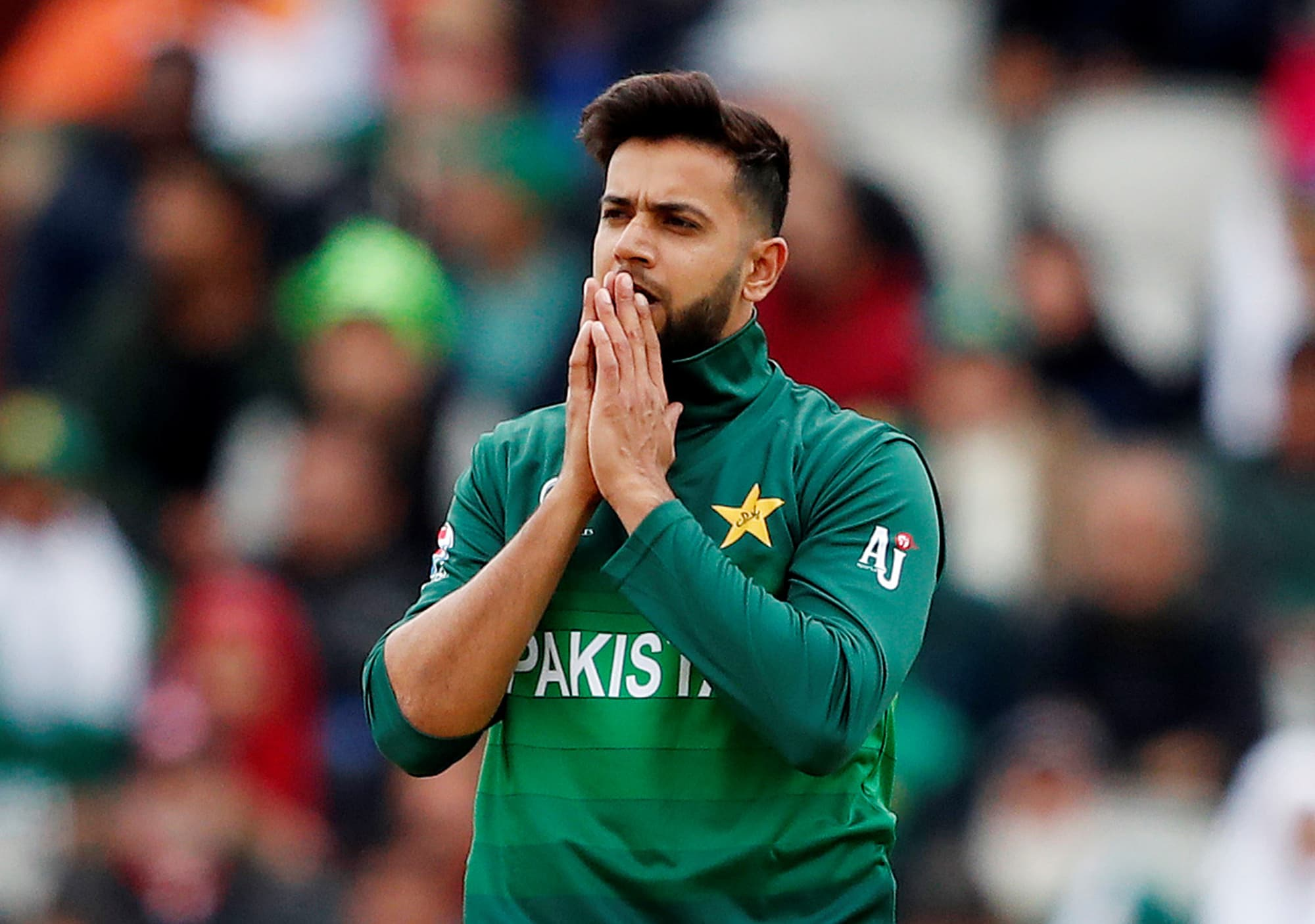 Imad Wasim reacts after bowling. ─ Reuters