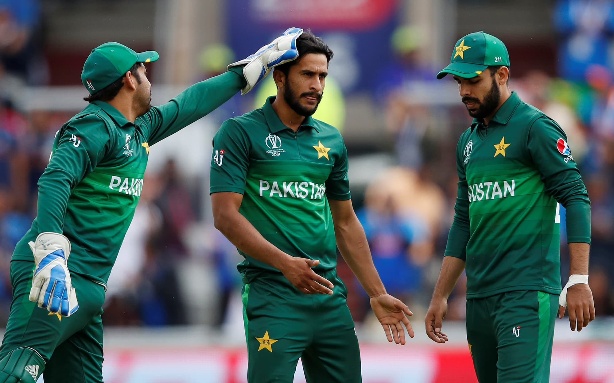 Hasan Ali celebrates the wicket of Rohit Sharma with team mates. ─ Reuters