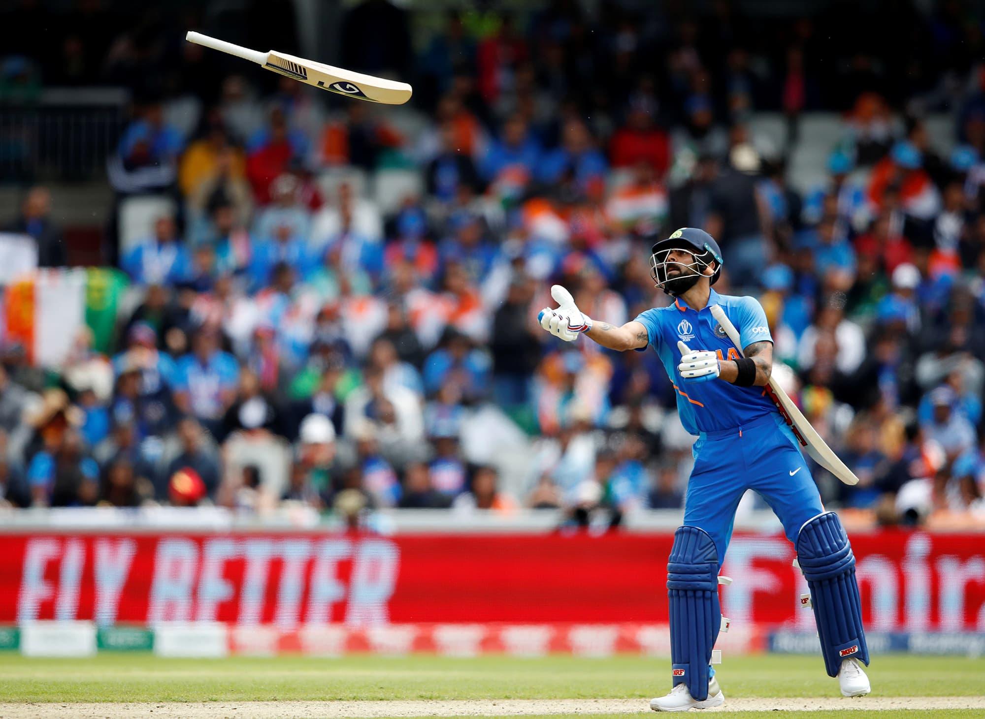 Virat Kohli throws Hardik Pandya his bat. ─ Reuters