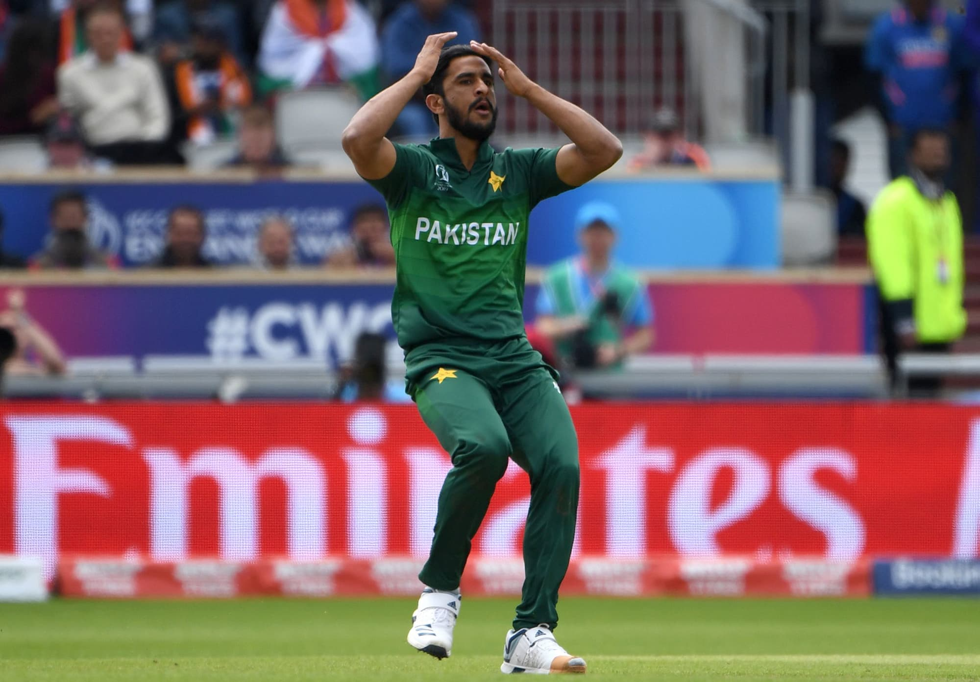 Hassan Ali reacts after being hit for a boundary. ─ AFP