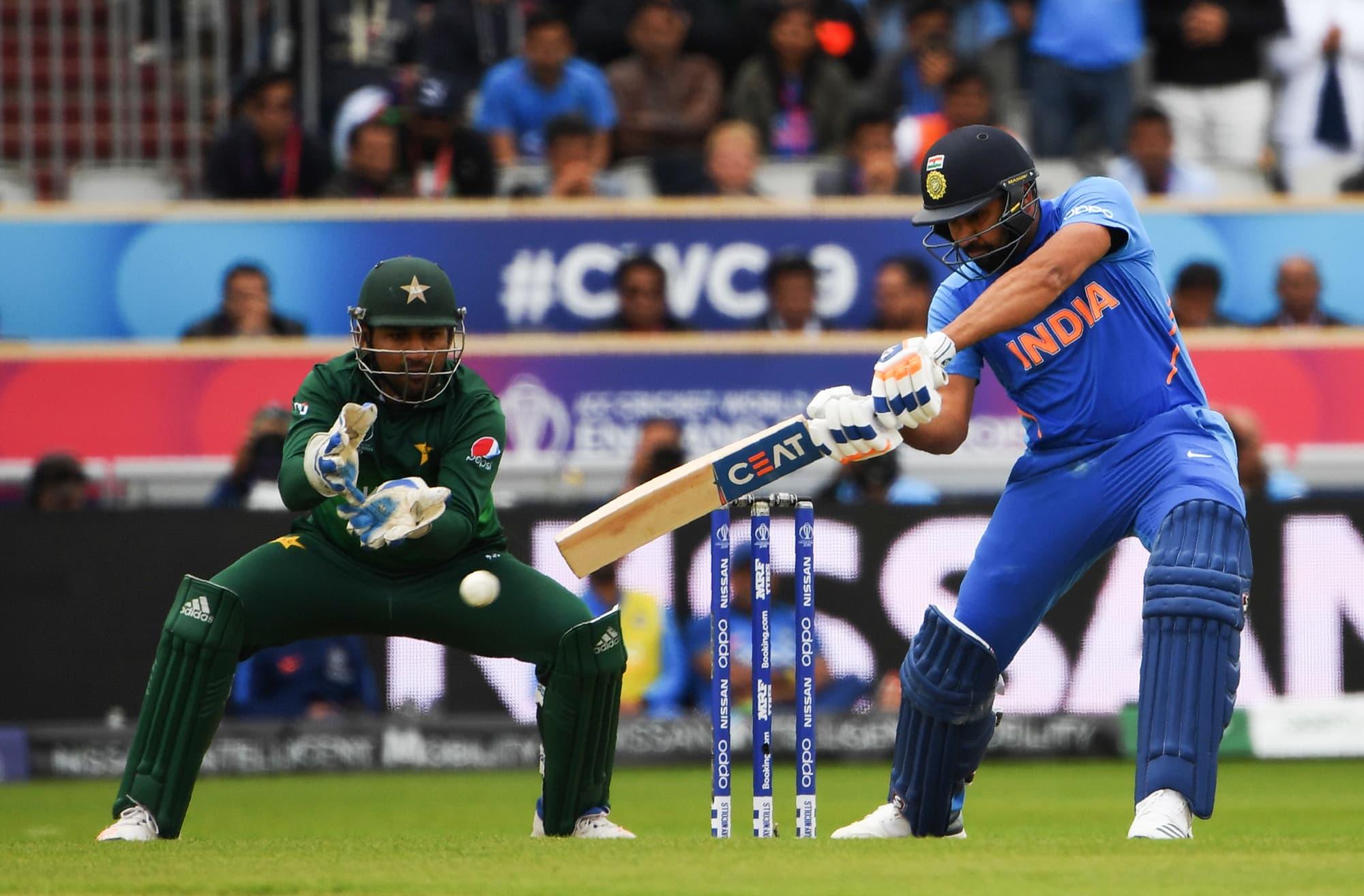 Rohit Sharma plays a shot as Sarfaraz Ahmed looks on. ─ AFP
