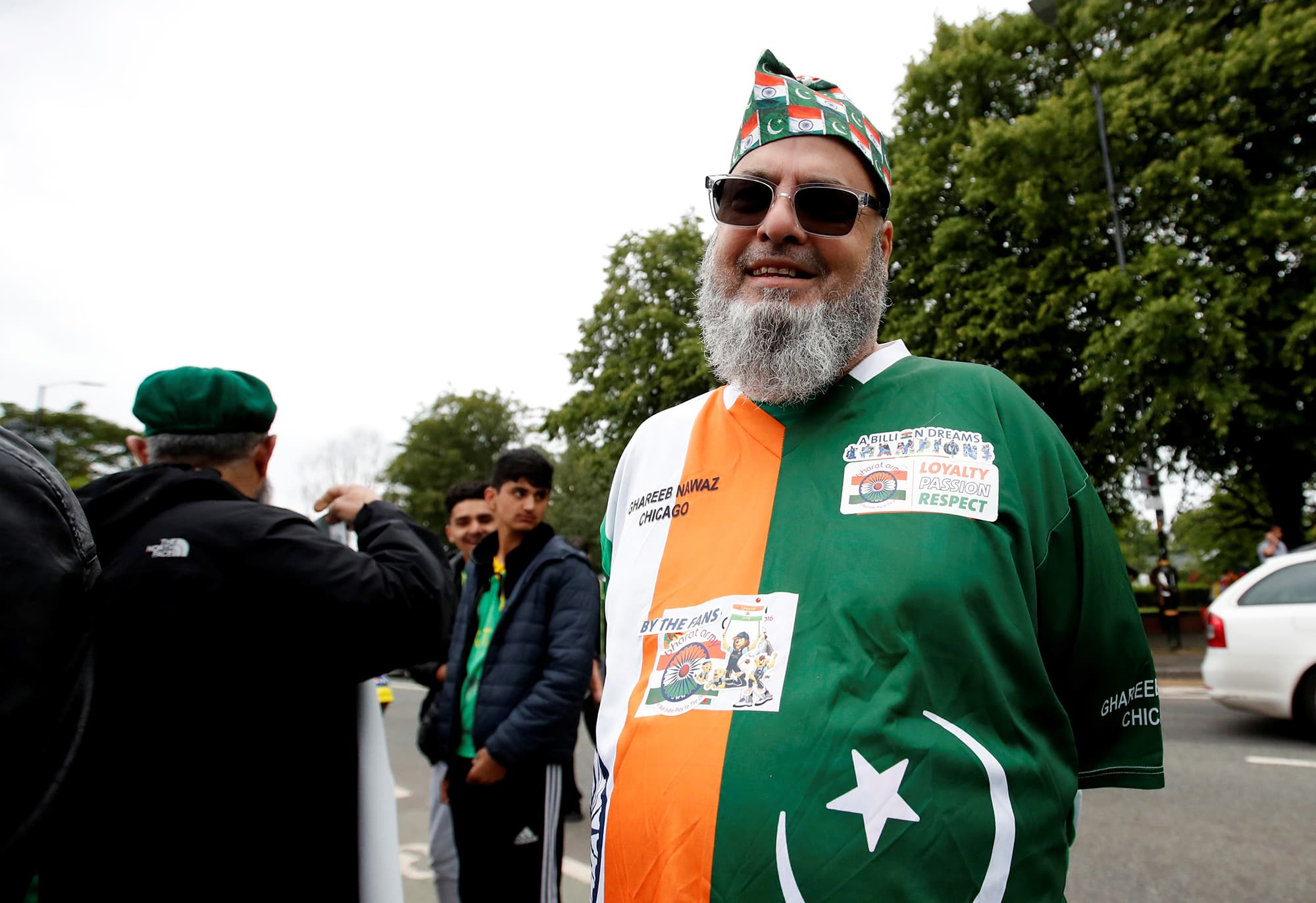 A rare supporter wearing Indian colours with the Pakistani flag's crescent-star superimposed on them outside the ground before the start of the match between India and Pakistan outside Old Trafford. ─ Reuters