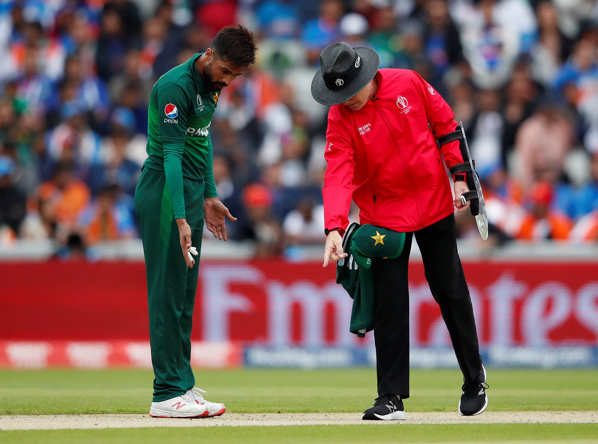 The umpire talks to Mohammad Amir about the crease. ─ Reuters