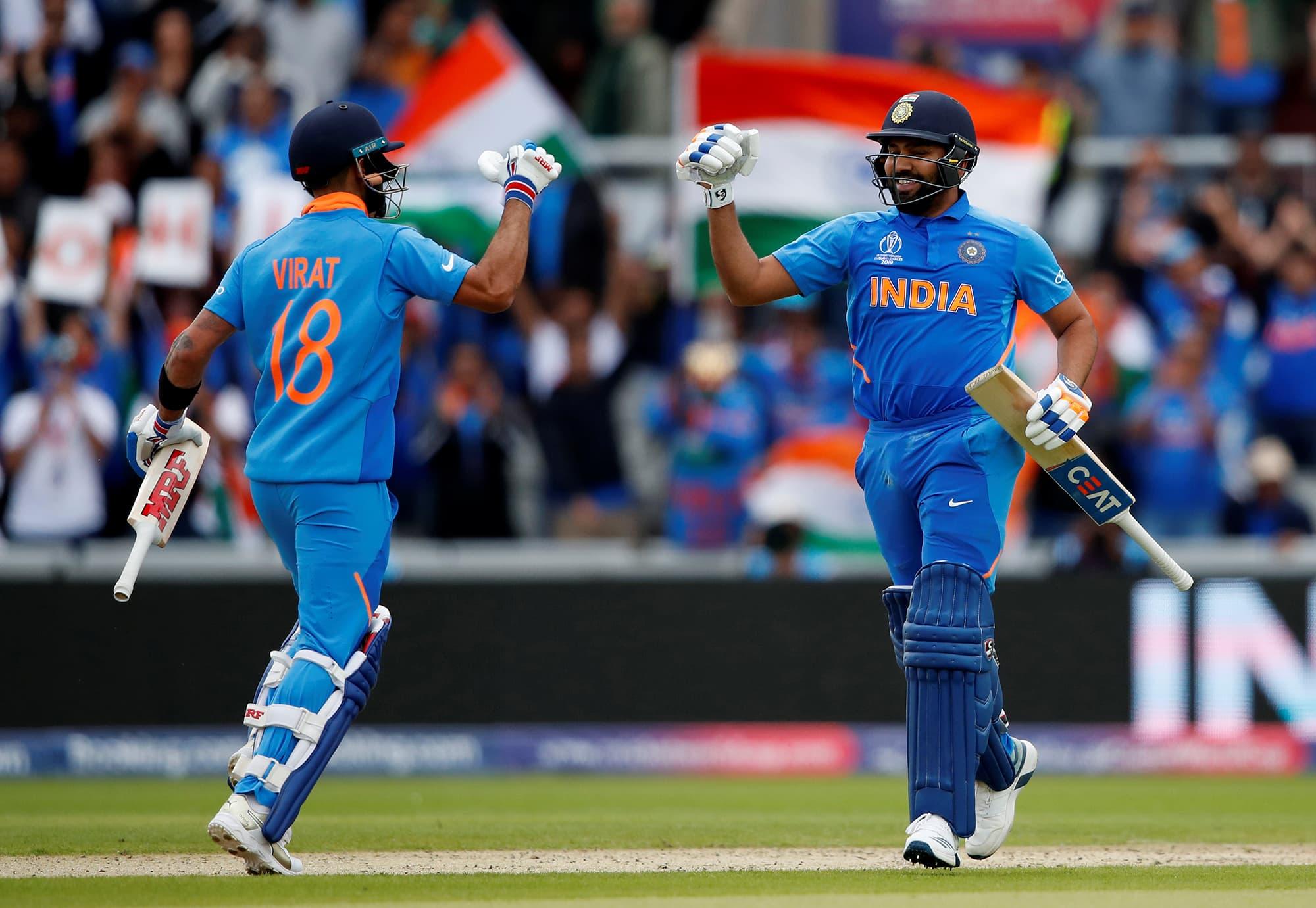Rohit Sharma celebrates his century with skipper Virat Kohli. ─ Reuters