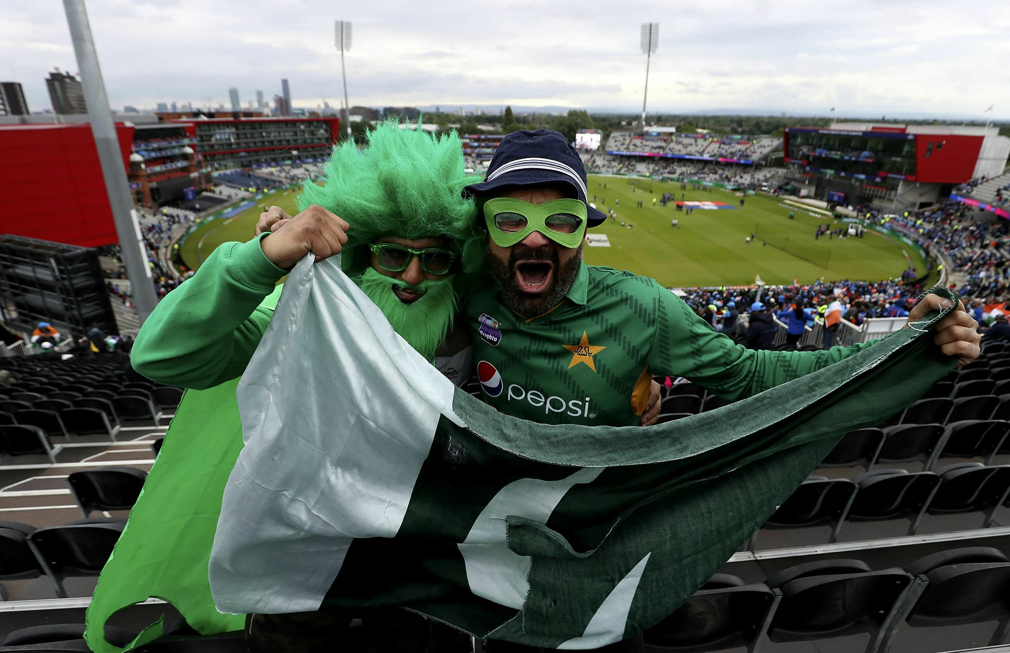 Pakistan fans pose for a photo in the stands prior to the start of play. ─ AP