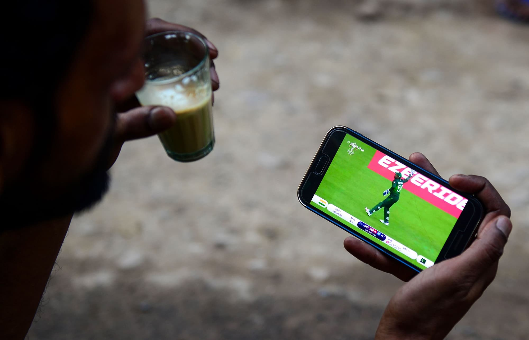An Indian fan has a cup of tea while watching a live broadcast of the match in Allahabad. ─ AFP
