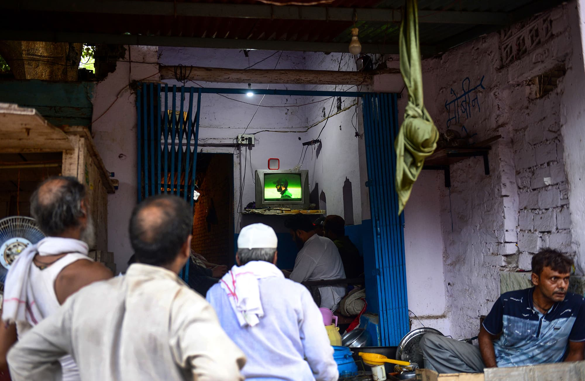 Indian men clamour outside a small teashop in Allahabad to watch a live broadcast of the match. ─ AFP