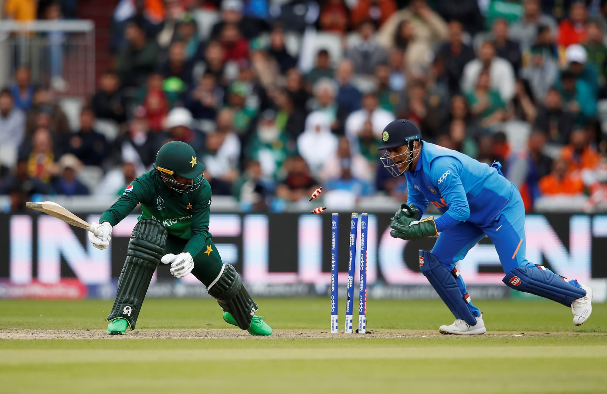 MS Dhoni attempts to stump out Fakhar Zaman. A review found Fakhar not out. ─ Reuters