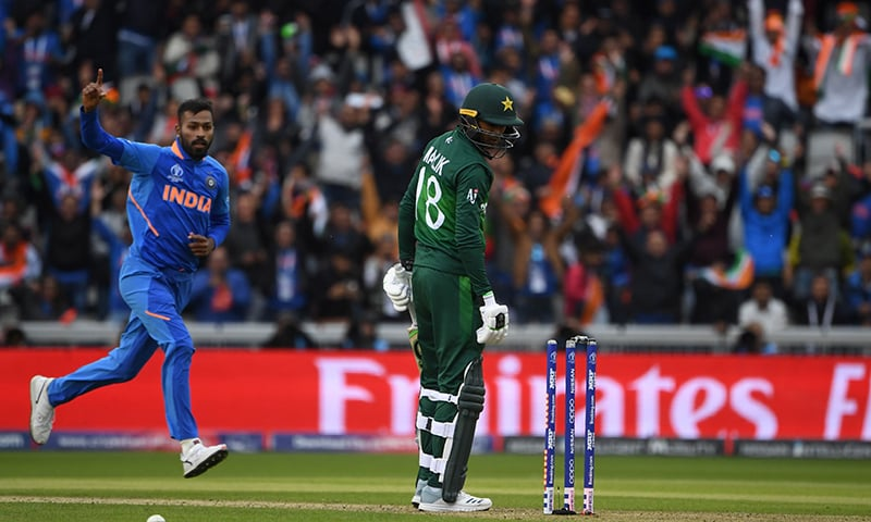 Hardik Pandya (L) celebrates after the dismissal of Pakistan's Shoaib Malik (R) during the 2019 Cricket World Cup group stage match between India and Pakistan. — AFP