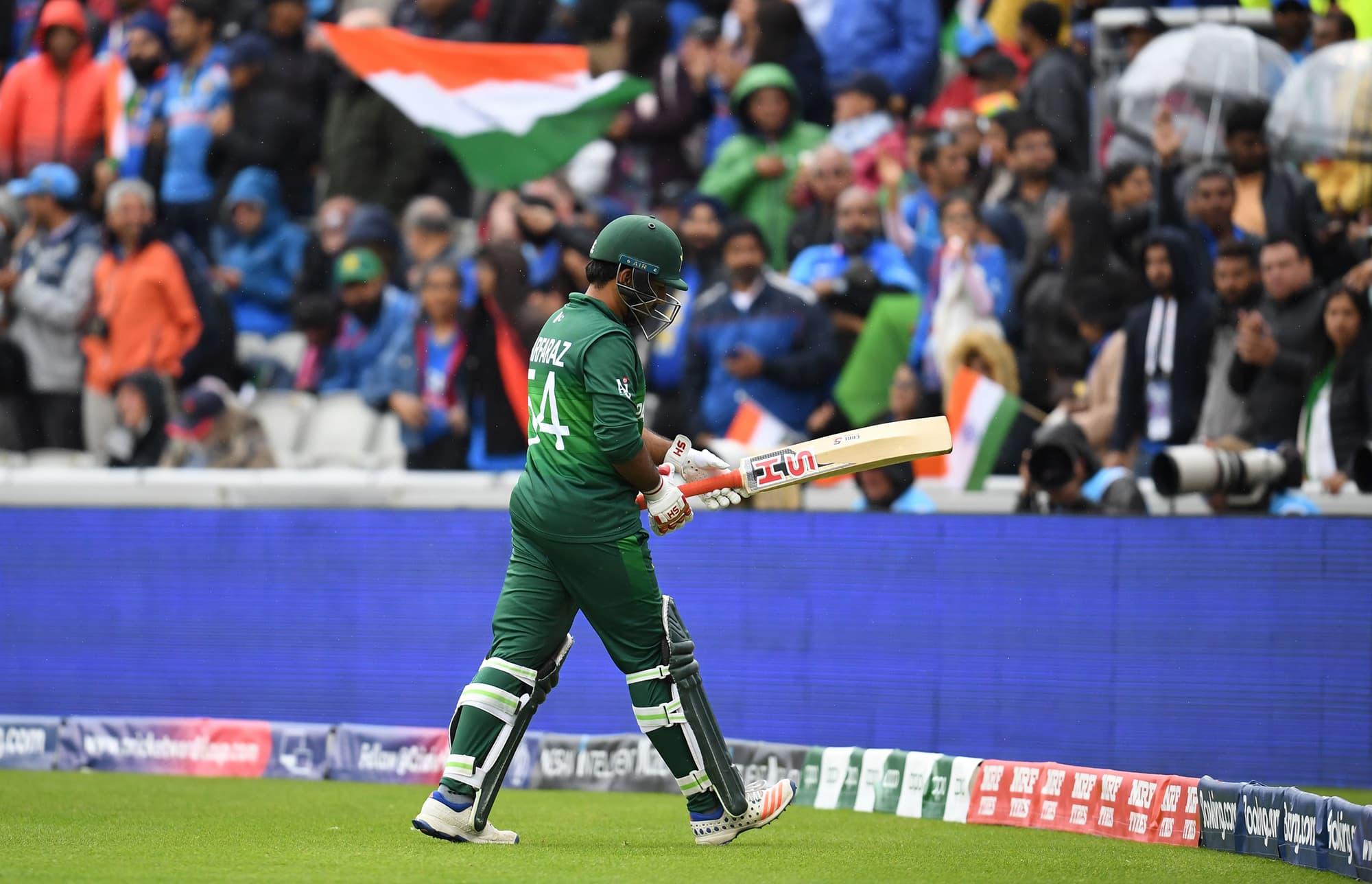 Skipper Sarfaraz Ahmed walks back to the pavilion after his dismissal. ─ AFP