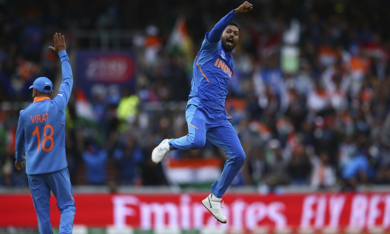 Hardik Pandya, right, celebrates taking the wicket of Pakistan's Shoaib Malik during the Cricket World Cup match between India and Pakistan. — AP