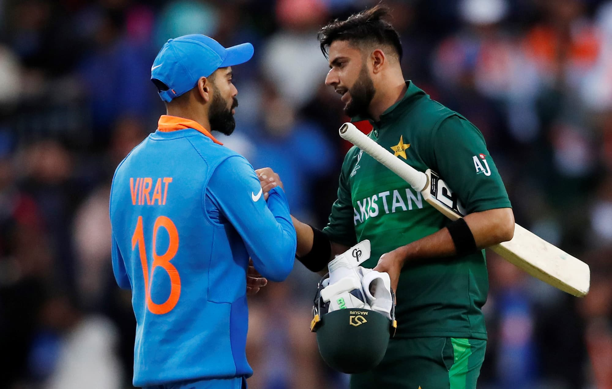 Virat Kohil shakes hands with Imad Wasim after the match. ─ Reuters
