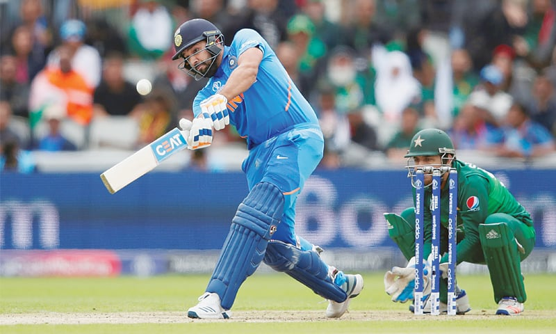 MANCHESTER: Indian opener Rohit Sharma hits over the top on his way to 140 as Pakistan captain Sarfraz Ahmed looks on during the World Cup match at Old Trafford on Sunday.—Reuters