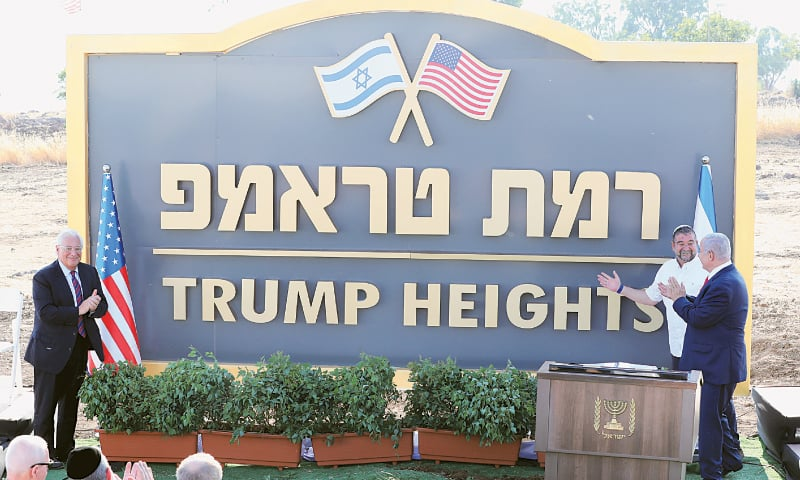 Israeli Prime Minister Benjamin Netanyahu and US ambassador to Israel David Friedman attend a ceremony to unveil a sign for a new Jewish settlement named after US President Donald Trump in the Israeli-occupied Golan Heights. — Reuters