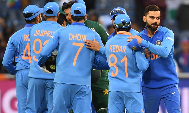 India's captain Virat Kohli celebrates with teammates after victory in the 2019 Cricket World Cup group stage match between India and Pakistan at Old Trafford in Manchester on June 16. — AFP