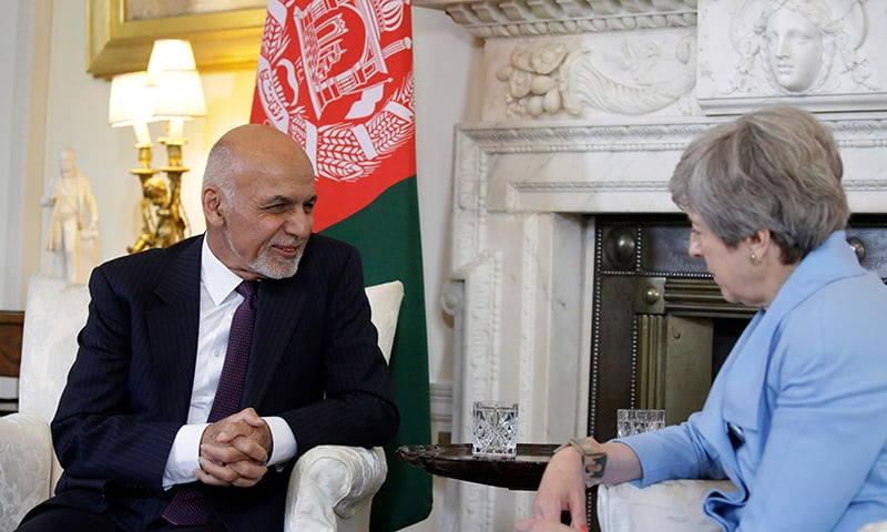 British Prime Minister Theresa May (R) speaks with Afghanistan's President Ashraf Ghani at the start of their meeting inside 10 Downing Street in London on June 17, 2019. ─ AFP