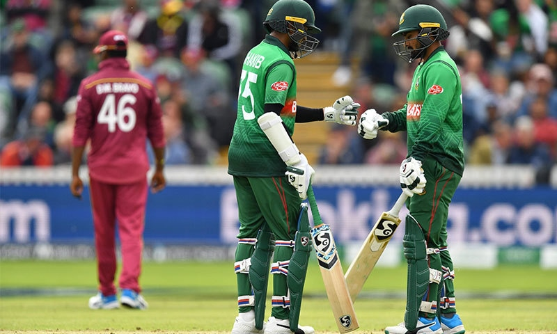 Bangladesh's Shakib Al Hasan (C) celebrates scoring 50 runs with Bangladesh's Liton Das (R) during the 2019 Cricket World Cup group stage match between West Indies and Bangladesh at The County Ground in Taunton, southwest England, on June 17, 2019. Photo: AFP