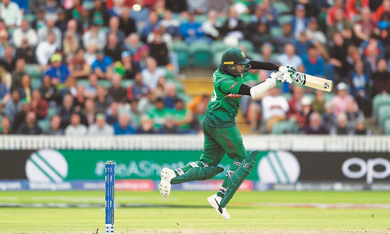 TAUNTON: Bangladesh batsman Shakib Al Hasan plays a shot during his century knock against the West Indies at the County Ground on Monday.—AP
