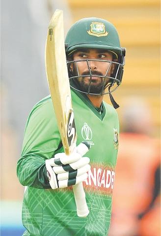 BANGLADESH batsman Liton Das celebrates after reaching his half-century on Monday.—AFP