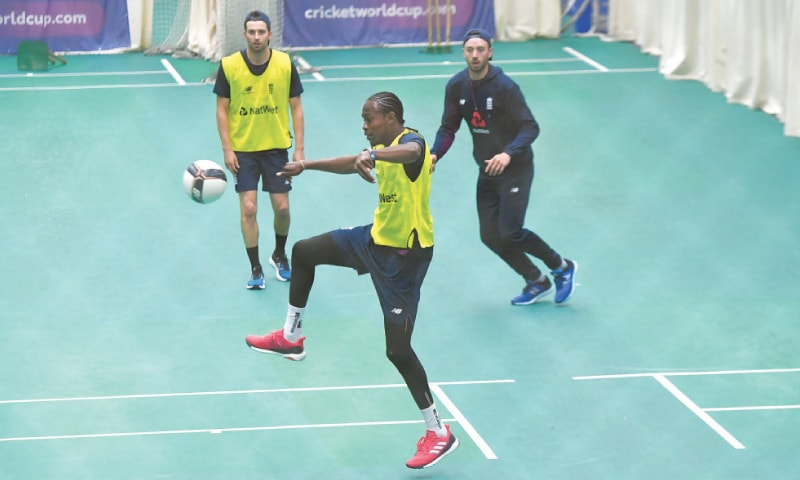 MANCHESTER: England's Jofra Archer plays football with team-mates during a training session at Old Trafford on Monday.—AFP