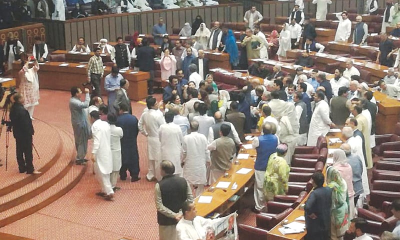 ISLAMABAD: Ruling PTI lawmakers protesting during Leader of the Opposition in the National Assembly Shahbaz Sharif's speech in the lower house of parliament on Monday. — INP
