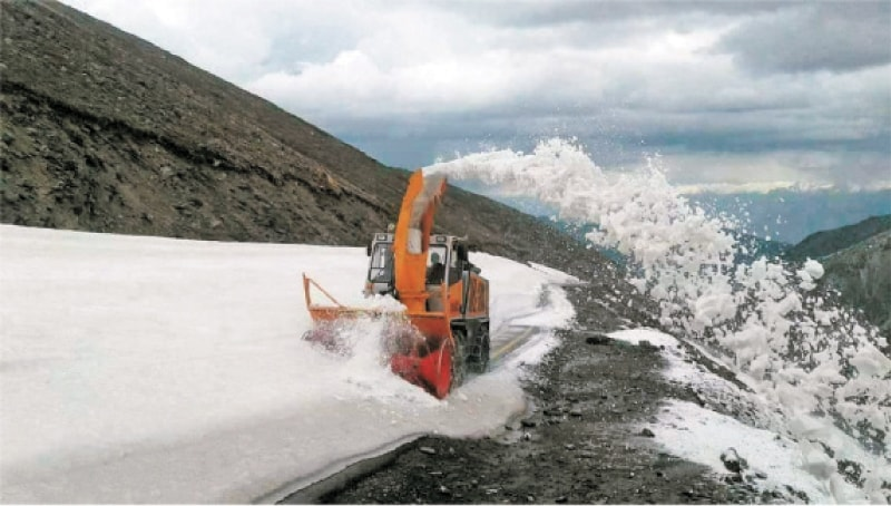 A snow removing machine clears last portion of Mansehra-Naran-Jalkhad Road on Monday. — Dawn