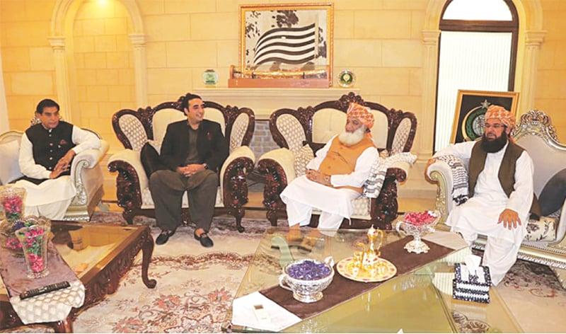 PPP chairperson Bilawal Bhutto-Zardari meets JUI-F chief Maulana Fazlur Rehman at his residence on Monday. Former premier Raja Pervez Ashraf and JUI-F's Maulana Abdul Ghafoor Haideri also attended the meeting.—Dawn