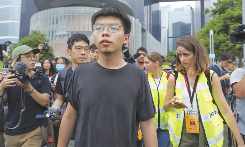 Protesters call for resignation of embattled HK leader