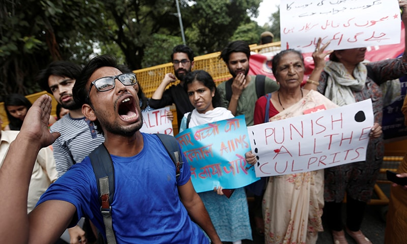 Protestors shout slogans during a protest against the deaths of children who have died this month from encephalitis, commonly known as brain fever, in Bihar, in New Delhi on June 17. — Reuters