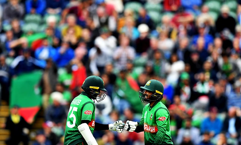 Bangladesh's Shakib Al Hasan (L) and Bangladesh's Liton Das tap gloves during the 2019 Cricket World Cup group stage match between West Indies and Bangladesh at The County Ground in Taunton. ─ AFP