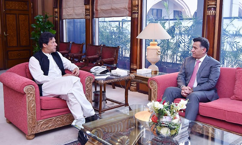 Prime Minister Imran Khan in conversation with DG ISI Faiz Hameed at the PM Office in Islamabad. — PM Office