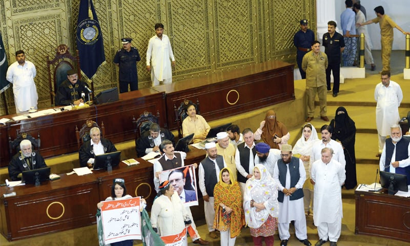 Opposition members stage a protest during the budget speech in KP Assembly on Tuesday. — Photo by Abdul Majeed Goraya