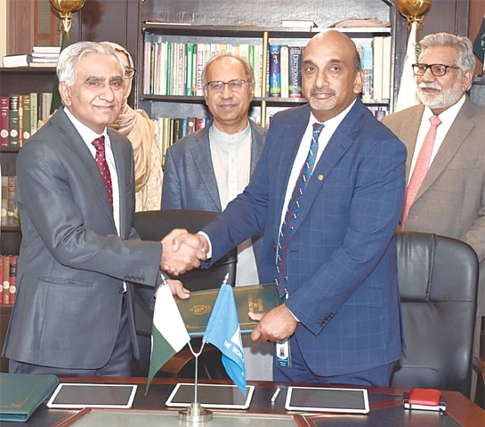 ADVISER to the Prime Minister on Finance Dr Abdul Hafeez Shaikh (centre) is all smiles as representatives of the government and the World Bank shake hands after signing the agreement.