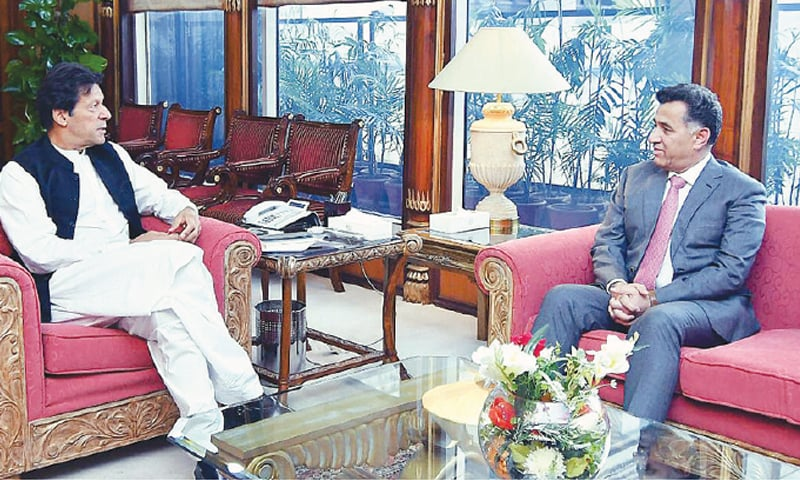 ISLAMABAD: Prime Minister Imran Khan speaks to ISI DG Lt Gen Faiz Hameed, who called on him at the PM Office on Tuesday.—APP